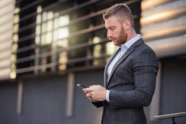 Mid adult man typing a text message. stock photo