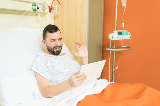 Mid Adult Man Video Conferencing In Hospital stock photo