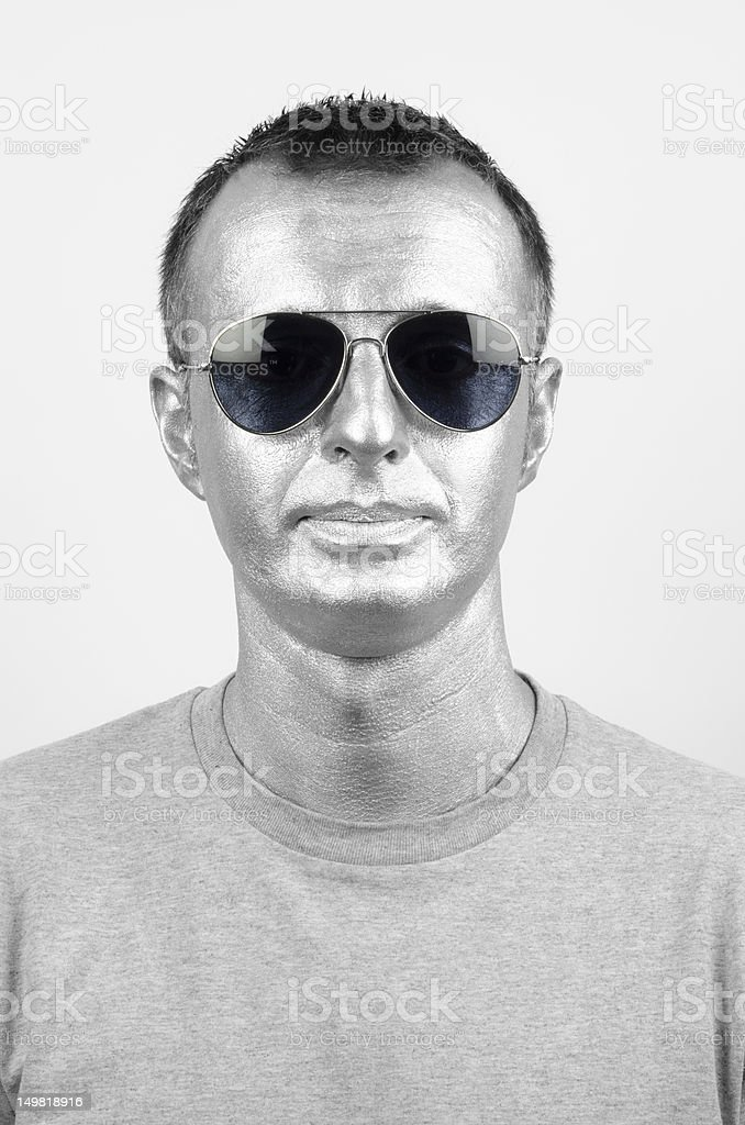 fc4d8a590a37 Mid adult man wearing silver make up and aviator sunglasses - Stock image .
