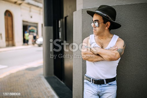 Mid adult man with dwarfism wearing cowboy hat on the street