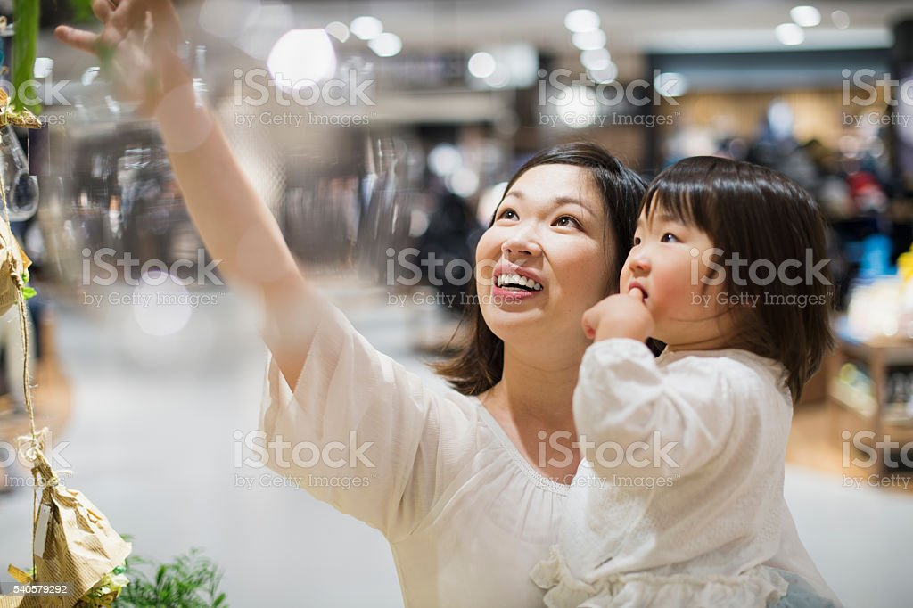 Mid adult mother in a supermarket with family stock photo
