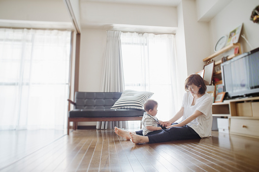 istock Mid adult mother loving her baby boy at home. 542080906