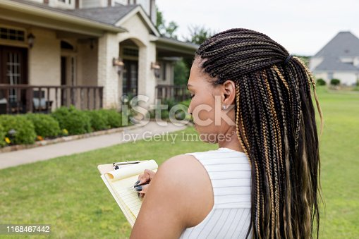 Before she puts the home on the market, the mid adult realtor evaluates the property.