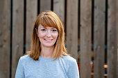 A Mid Adult Redhead Woman