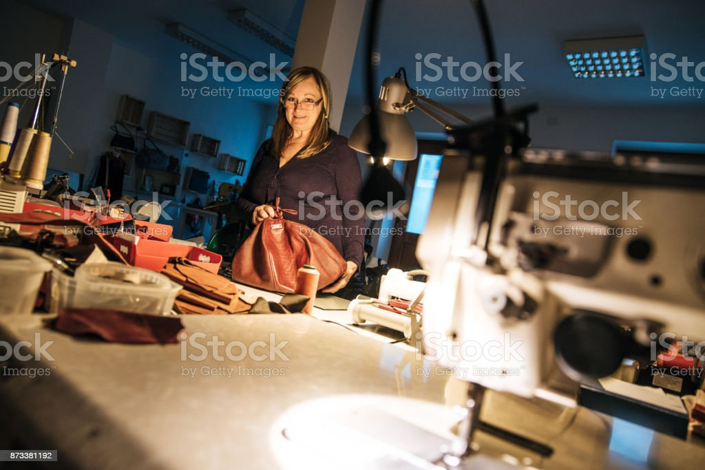 Mid Adult Seamstress Woman Working at Night stock photo