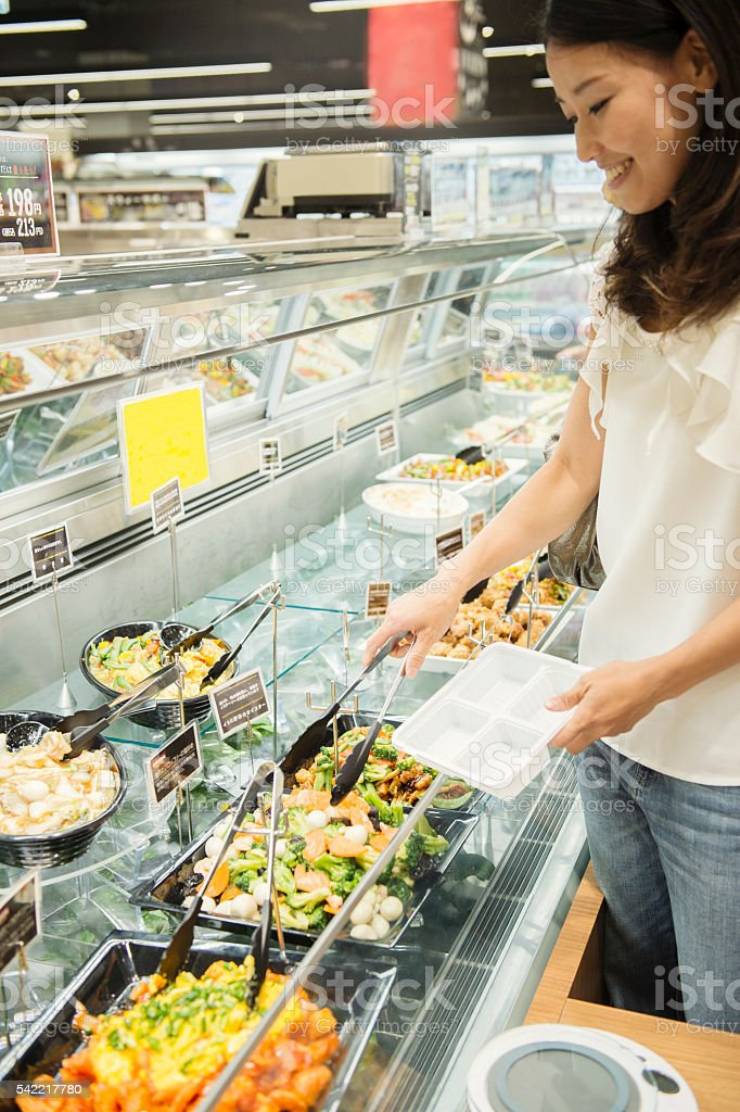 Mid adult woman buying grocery in supermarket stock photo