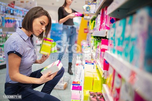 istock Mid adult woman choosing sanitary pads 1200887116