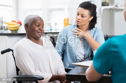 932074776istockphoto Mid adult woman discusses her mother's health with nurse 947503154