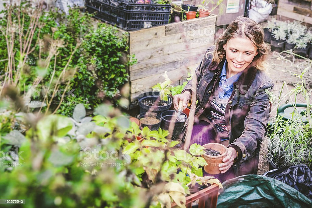 Mid Adult Woman Gardener Loving Plants royalty-free stock photo