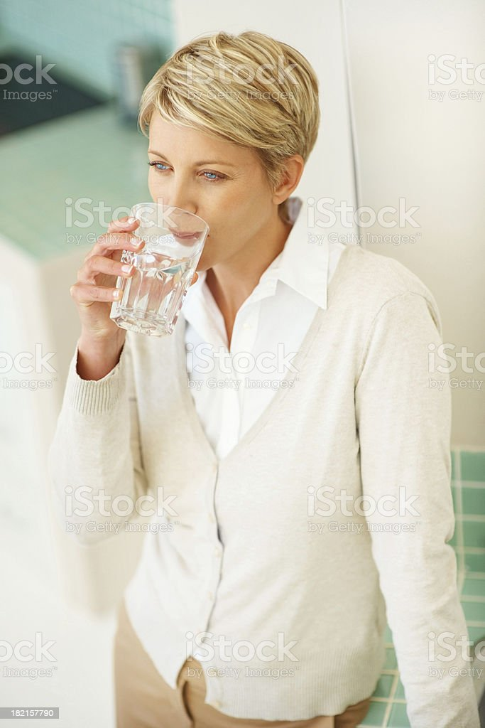 Mid adult woman having a glass of water royalty-free stock photo