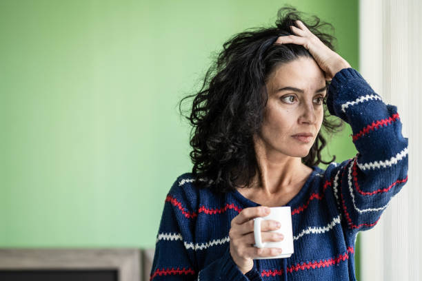 Mid adult woman in isolation at home during COVID-19 Mid adult woman in isolation at home during COVID-19 anxiety stock pictures, royalty-free photos & images