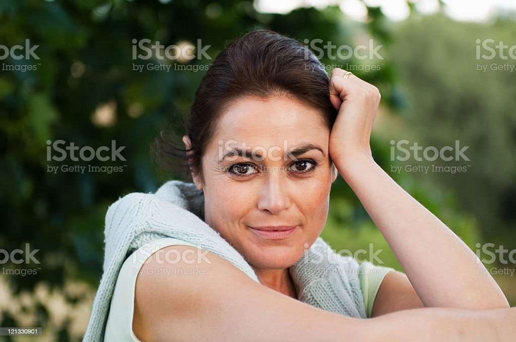 Mid adult woman looking at camera, portrait stock photo