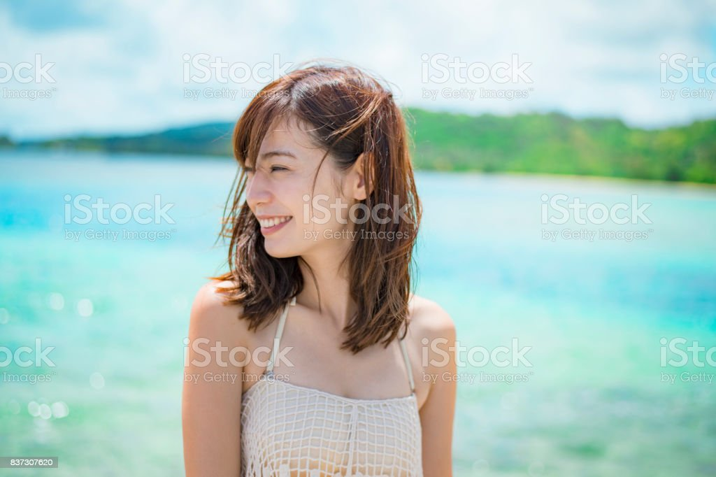 Mid adult woman on the beach in guam stock photo