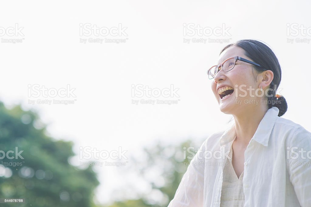 Mid adult woman portrait in park stock photo
