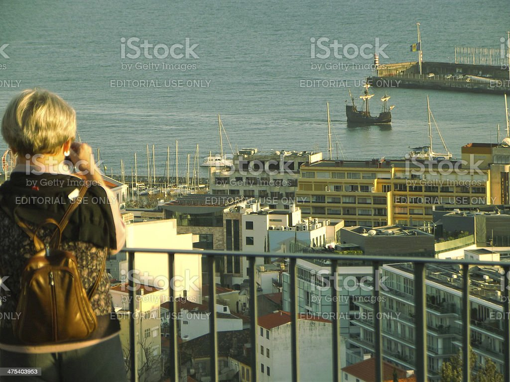 Mid adult woman shooting 15th century caravel royalty-free stock photo