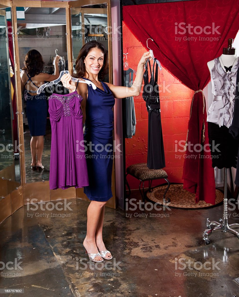Mid adult woman shopping in clothing boutique royalty-free stock photo