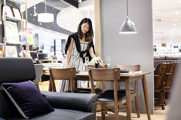 mid adult woman shopping in shopping mall. - furniture shopping stock photos and pictures