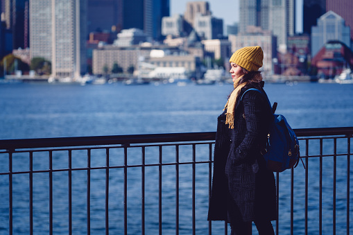 Mid Adult Woman Standing By Cityscape, Boston USA