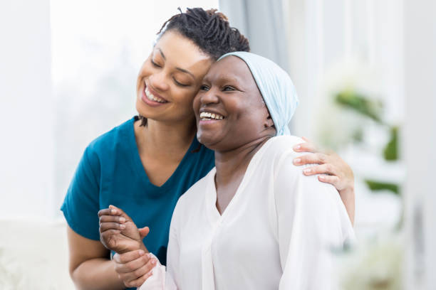 mid adult woman visits her elderly mother - cancer patient stock pictures, royalty-free photos & images