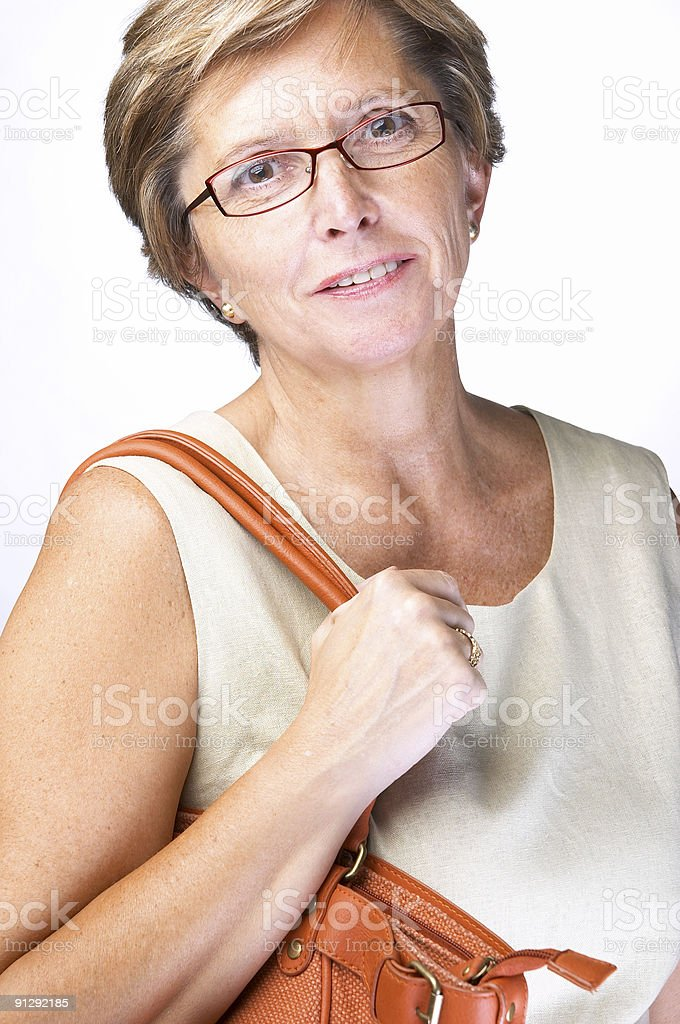 Mid adult woman with bag royalty-free stock photo
