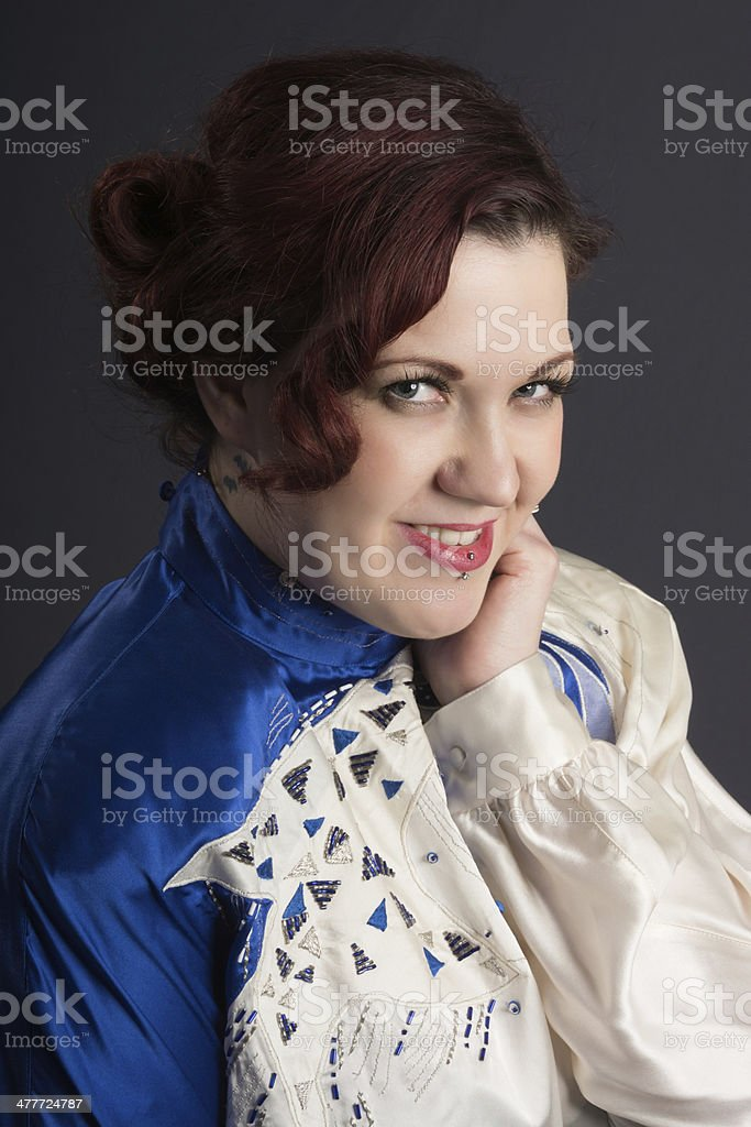 Mid adult woman with playful smile. royalty-free stock photo