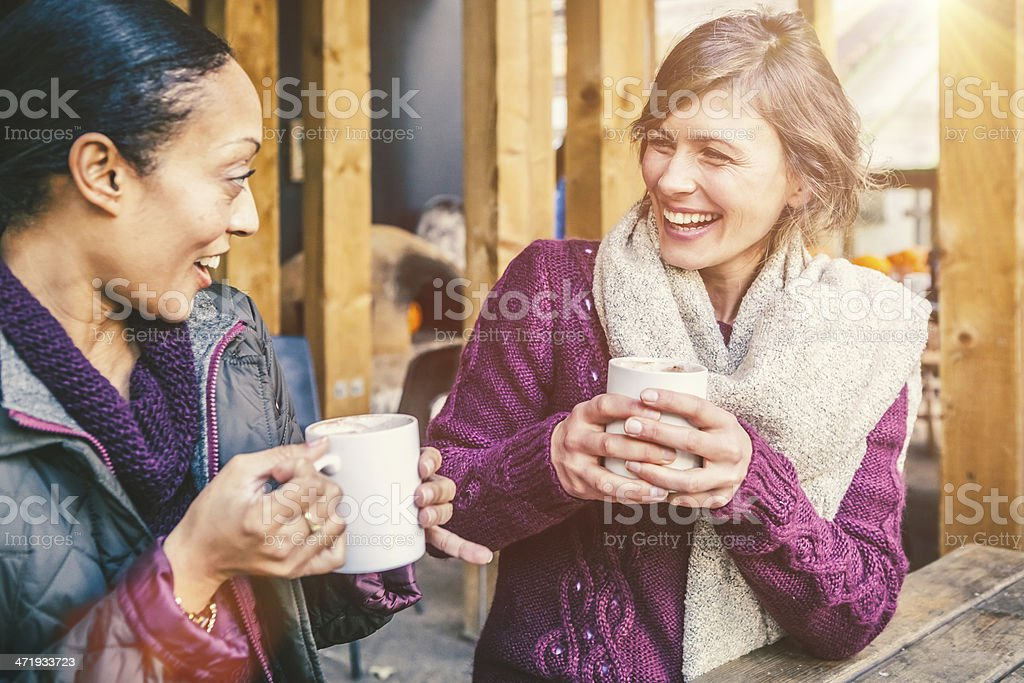 Mid Adult Women Enjoying a Warm Cup of Coffee stock photo