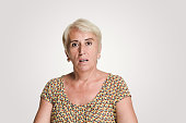 istock Mid adult women looking at camera with a shock expression 1134240319