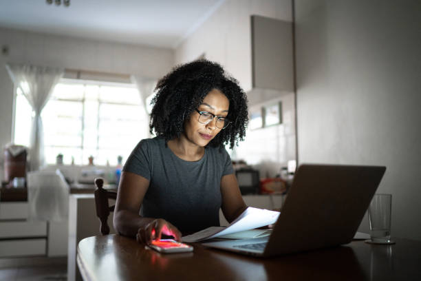 Mid adult women working at home stock photo