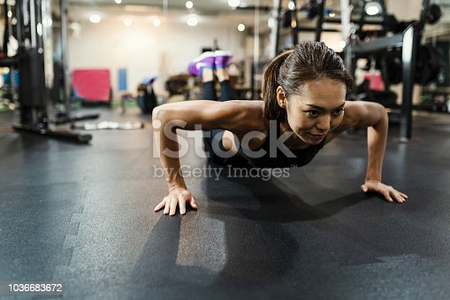 istock Mid adult women working out at at cross gym 1036683672