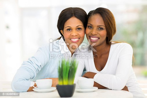 istock mid age african mother and adult daughter 515065907