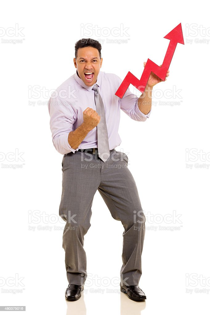 mid age businessman holding stock arrow stock photo