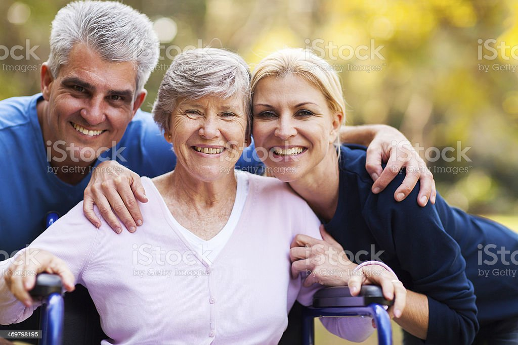 mid age couple and senior mother stock photo