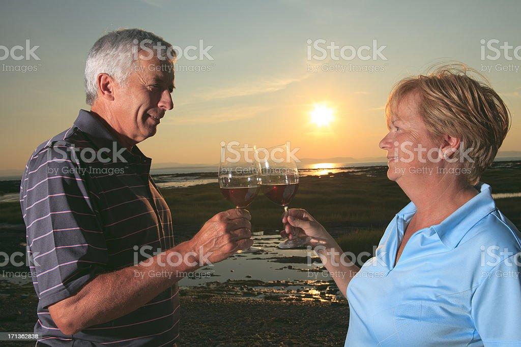 Mid Age Couple Sunset - Wine Sun royalty-free stock photo