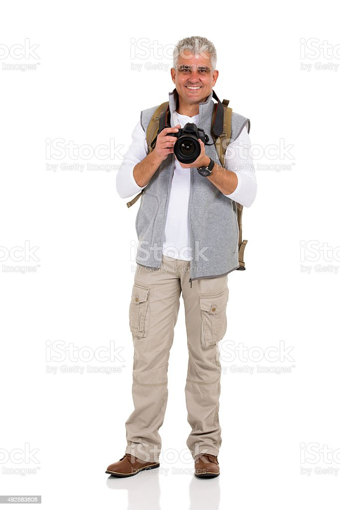 mid age male hiker holding digital camera stock photo