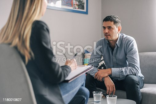 Mid age man having on on one counseling meeting in his home