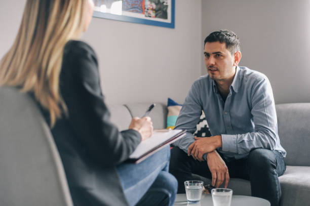 Mid age man having on on one counselling meeting stock photo