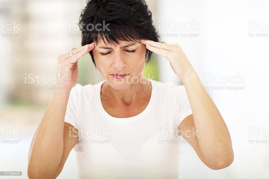 mid age woman having headache royalty-free stock photo