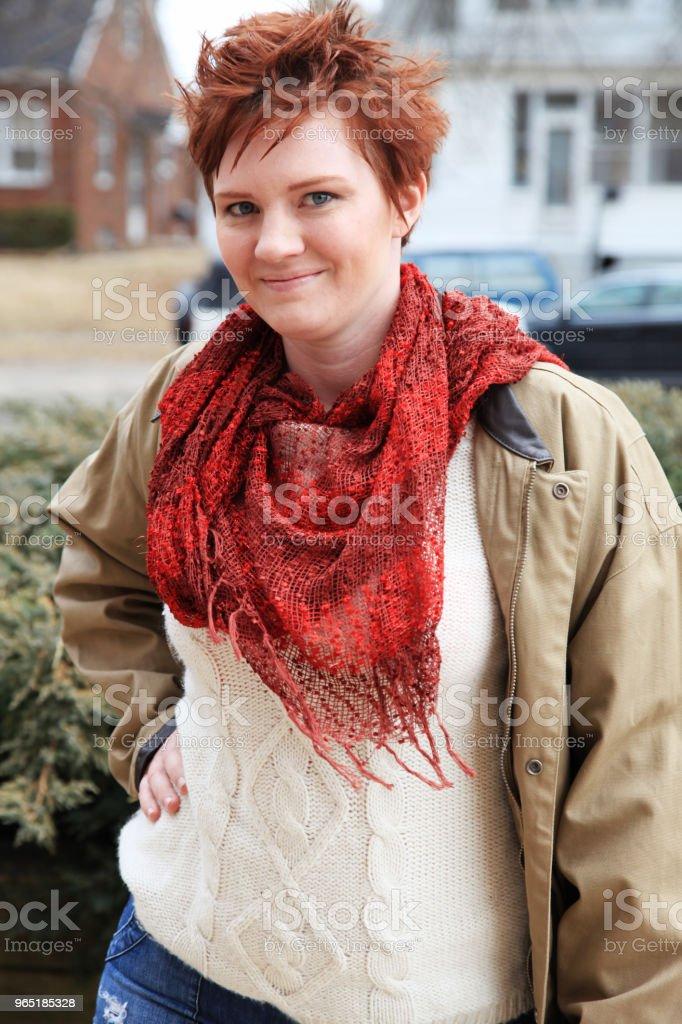 mid age woman in autumn clothing zbiór zdjęć royalty-free