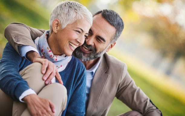Mid aged couple in a park stock photo
