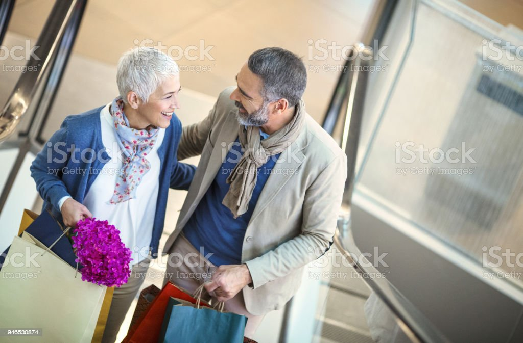 Mid aged couple in a shopping mall. stock photo