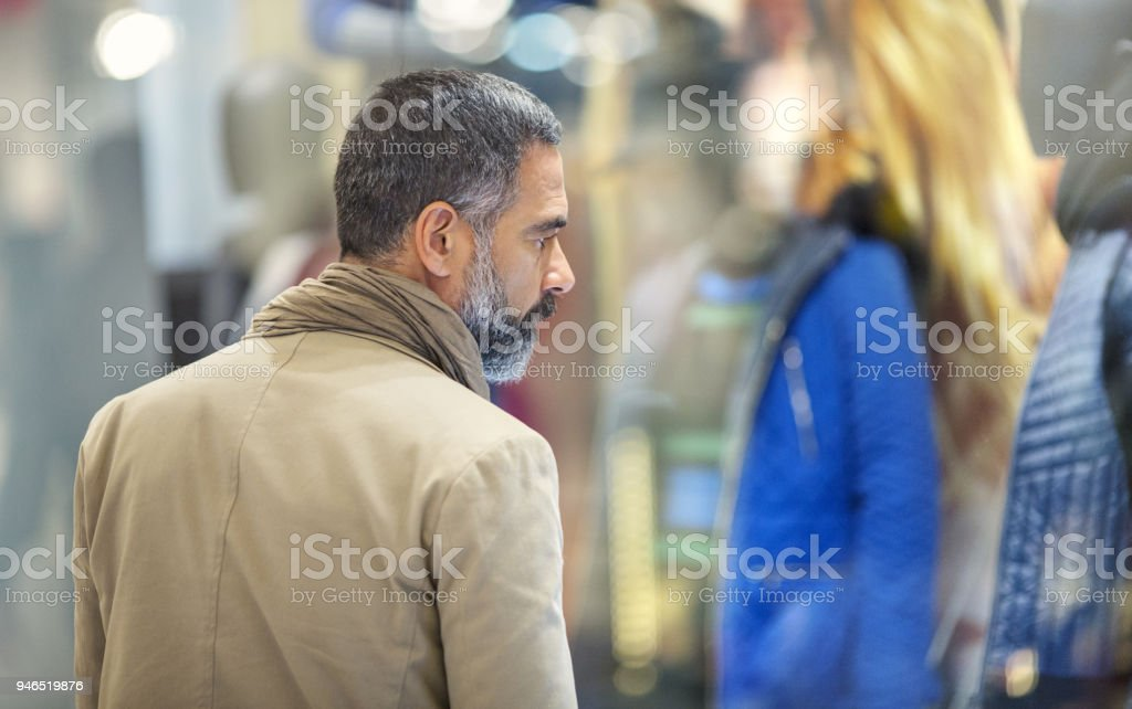 Mid aged man in a shopping mall. stock photo