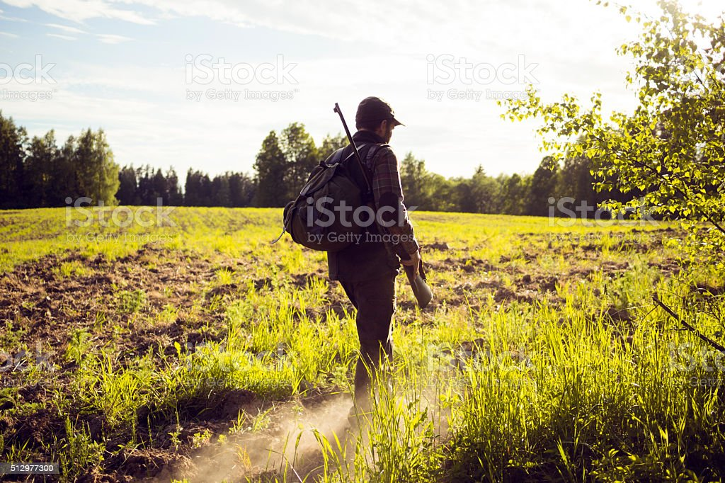 MId Aged Man Walking Through A Field In The Countryside stock photo