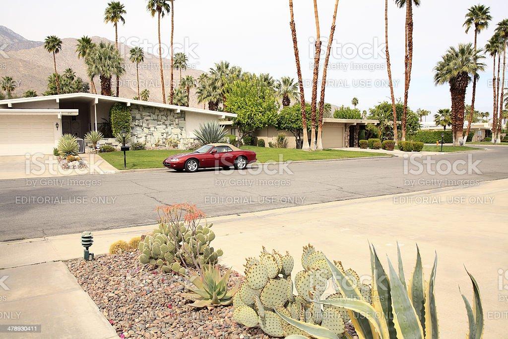 Mid Century California Neighborhood With Luxury Car stock photo