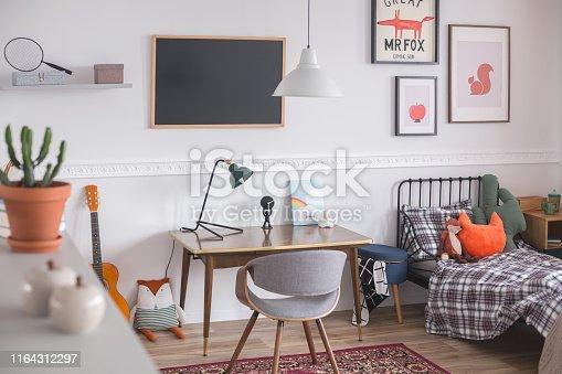 Mid century furniture in genderless white bedroom for kid