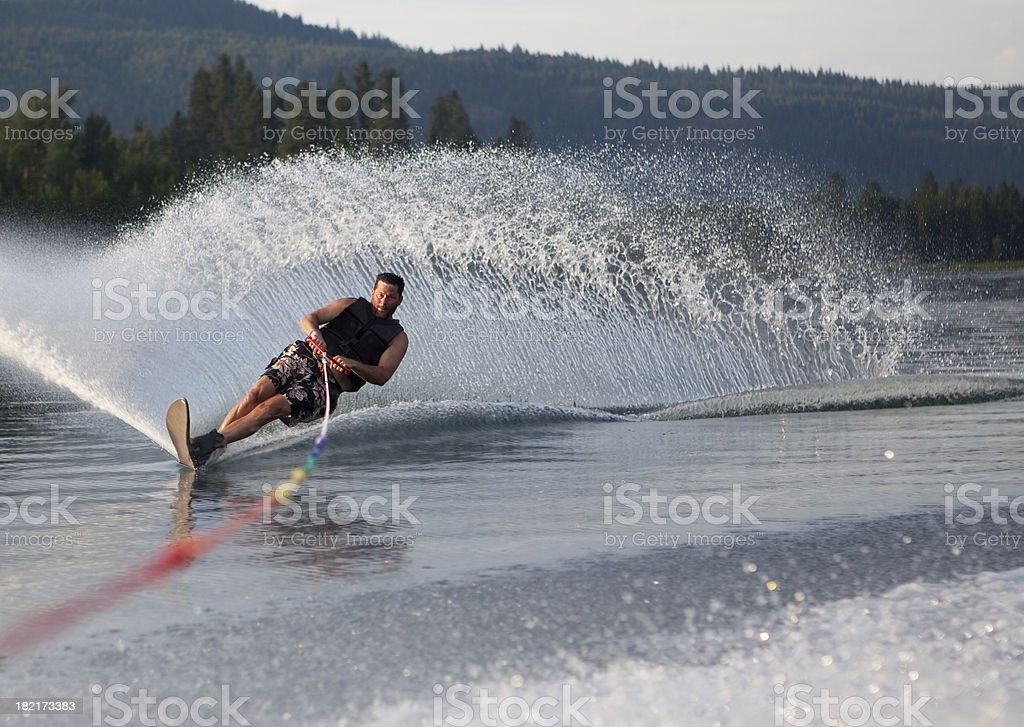 Mid forties male waterskiing stock photo