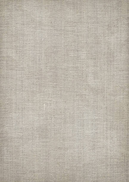 Mid gray linen textured fabric with visible weave This large, high resolution antique artist linen duck canvas blotted vignetted grunge texture is excellent choice for implementation in various 2D and 3D CG design projects.  canvas fabric stock pictures, royalty-free photos & images