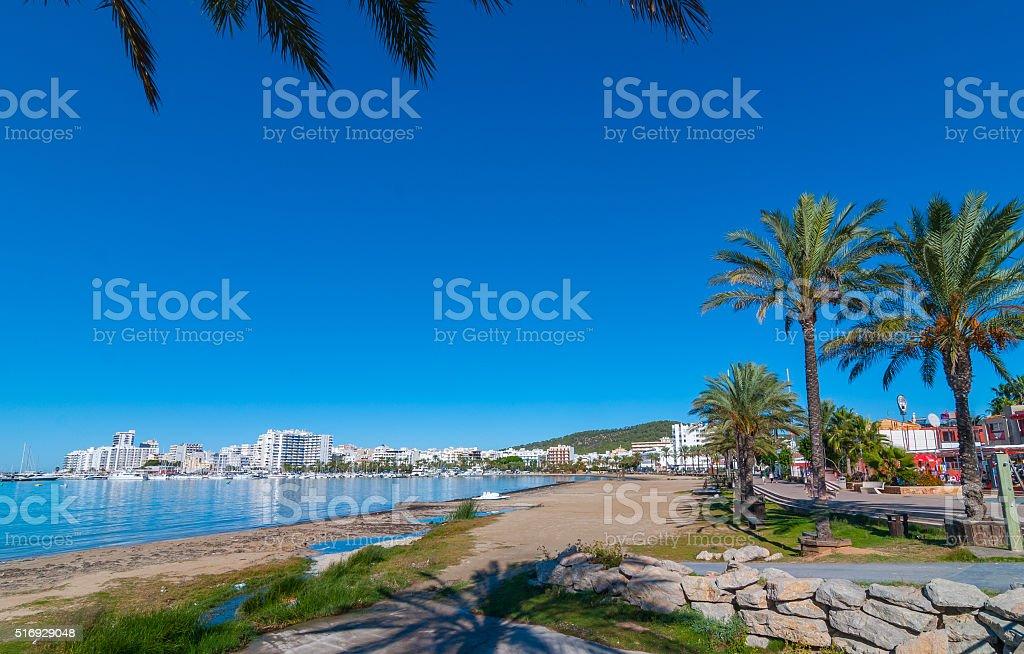 Mid morning sun on Ibiza waterfront and beach. stock photo