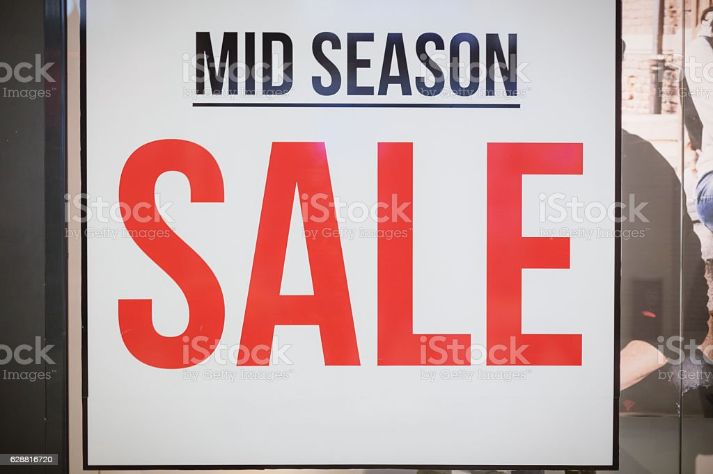 mid season SALE - billboard in shop window stock photo