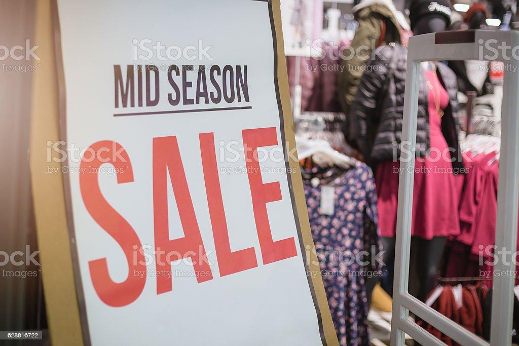 mid season SALE - billboard in shop window stock photo