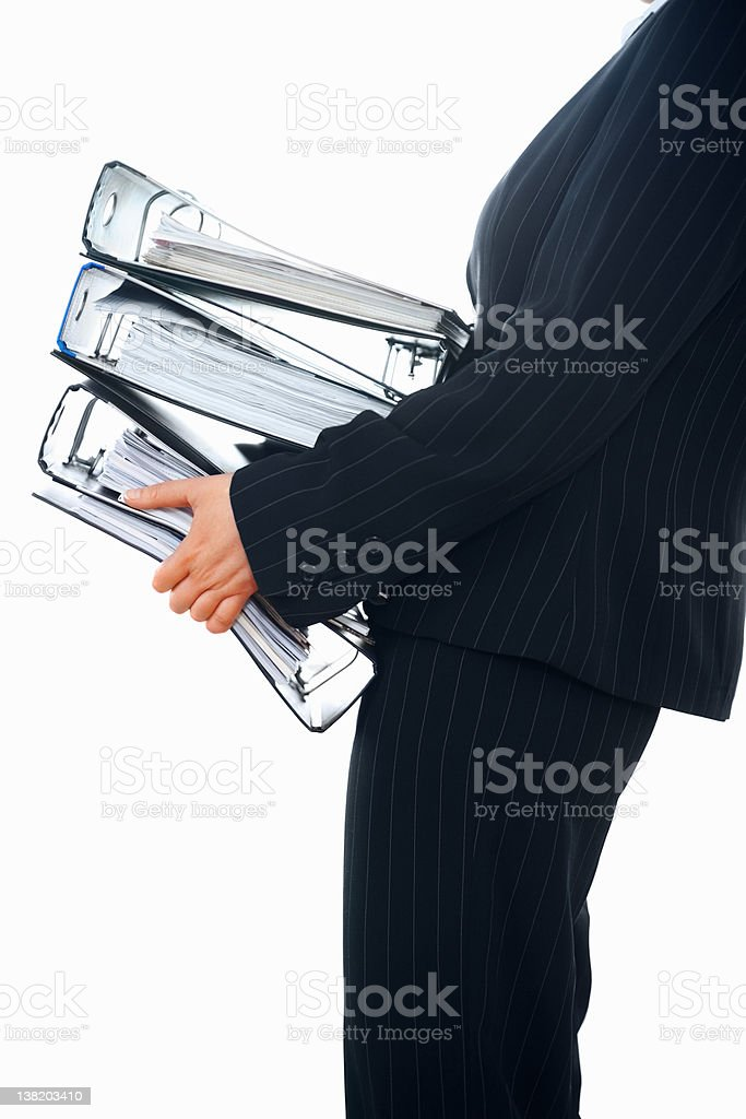 Mid section of a business person carrying heavy files royalty-free stock photo